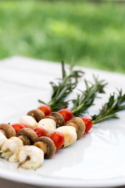 grilled caprese salad kebab skewers with rosemary and mushrooms